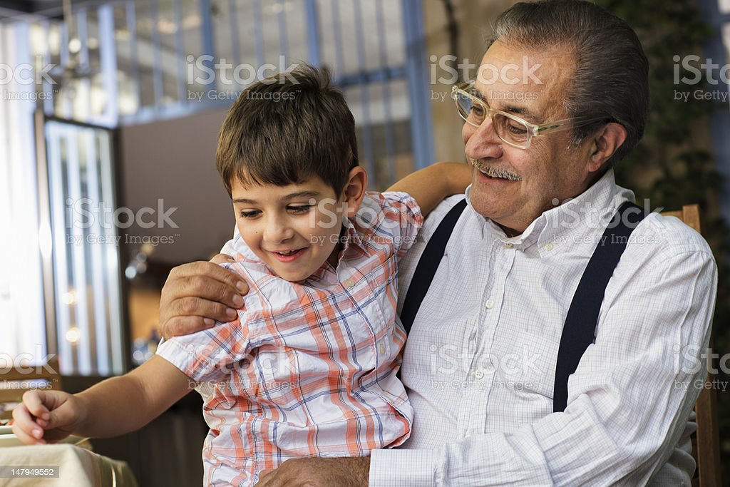 Proud Italian Grandfather plays with his grandson royalty-free stock photo