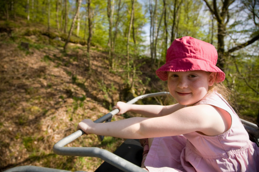 Proud Little Girl In Chairlift Stock Photo - Download Image Now