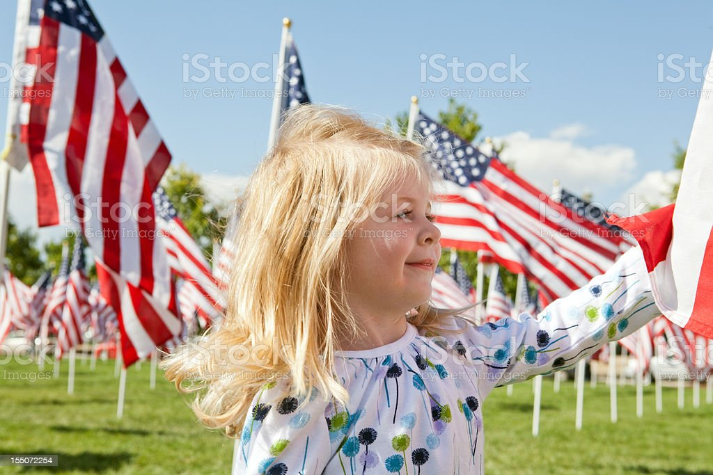 Proud little girl with American Flags royalty-free stock photo