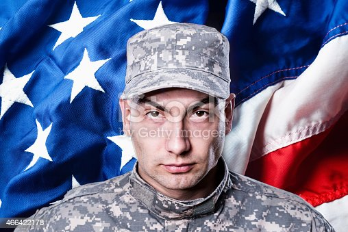 istock Proud male army soldier on american flag background 466422178