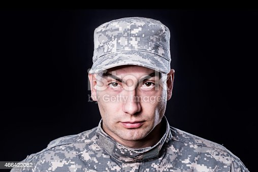 840615050 istock photo Proud male army soldier on black background 466422082