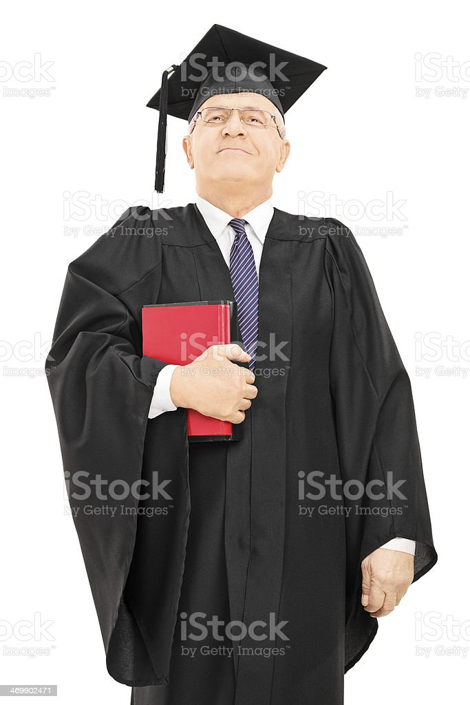 Proud male college professor holding books and standing stock photo