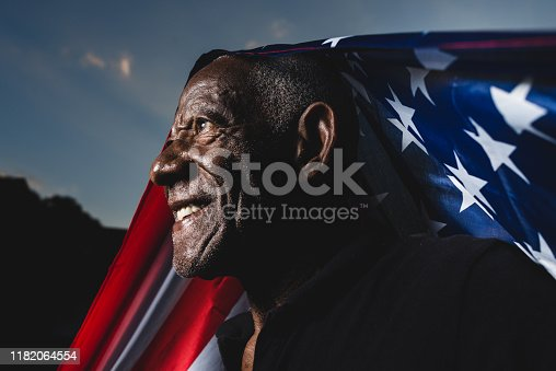Proud man raising the flag of the United States of America