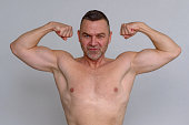 istock Proud middle-aged man showing off his physique 932846486