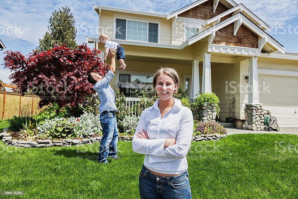 Proud Mother at Home with Family stock photo