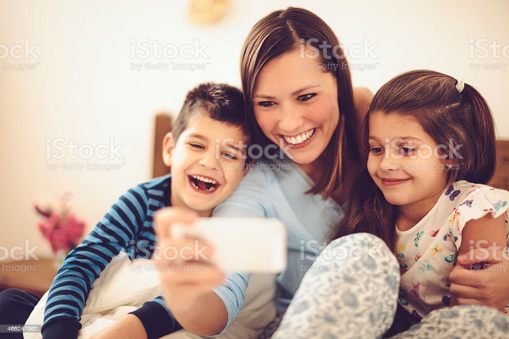 Proud mother takes selfies with her children stock photo