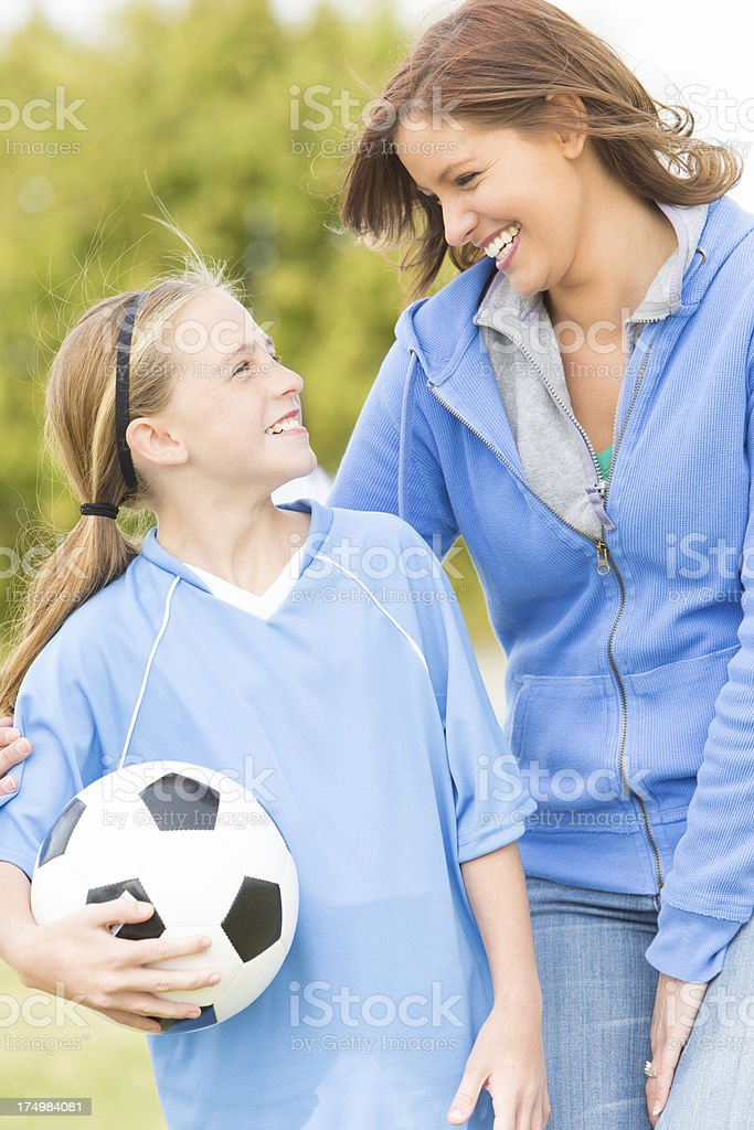 Proud mother with her soccer playing daughter stock photo