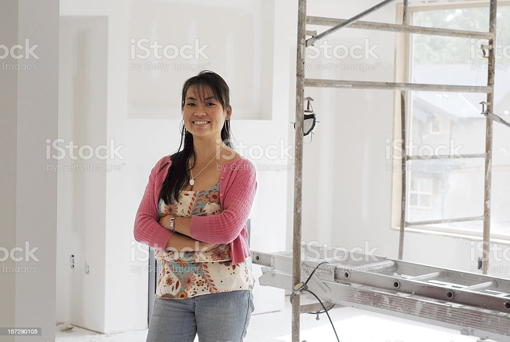 Proud New Homeowner Standing in Home Smiling About It royalty-free stock photo