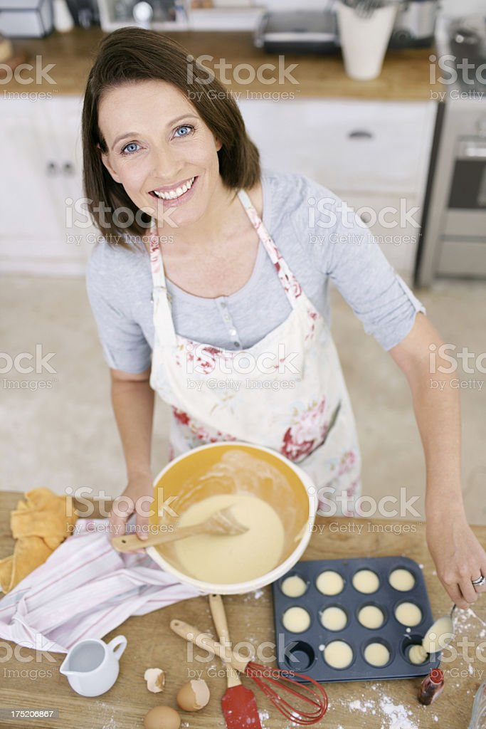 Proud of her baking thus far royalty-free stock photo