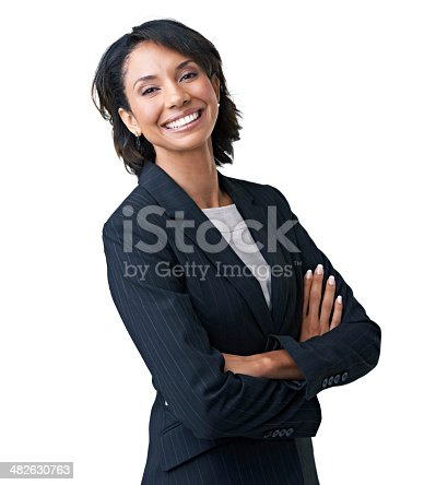 Attractive female executive laughing against a white background with her arms folded