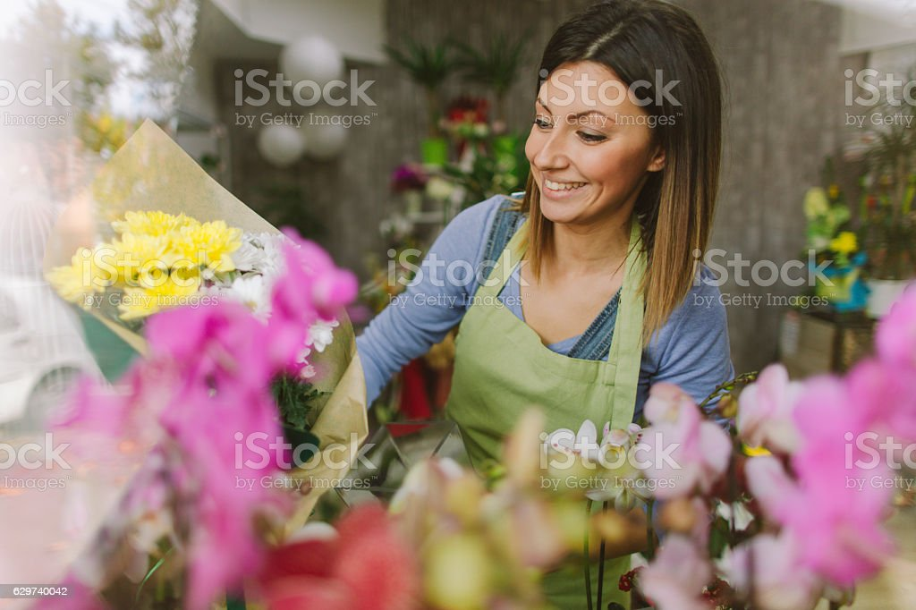 Proud owner of a floral shop stock photo