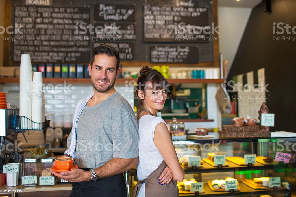 Proud owners in their restaurant stock photo