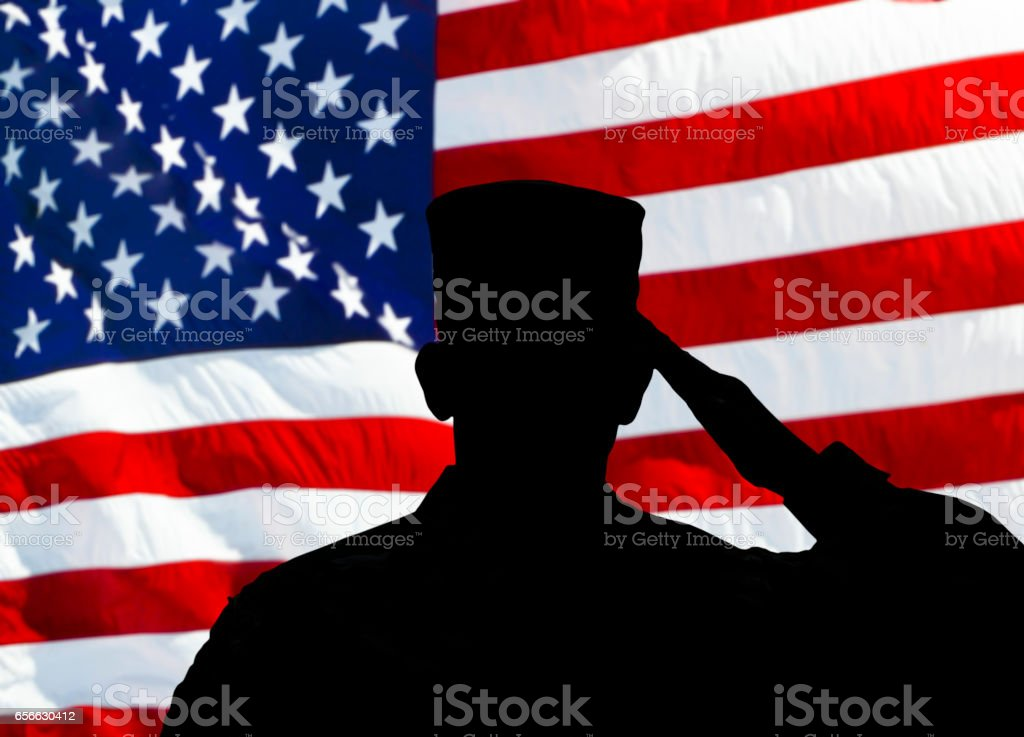 Proud Saluting Male Army Soldier On American Flag Background Stock
