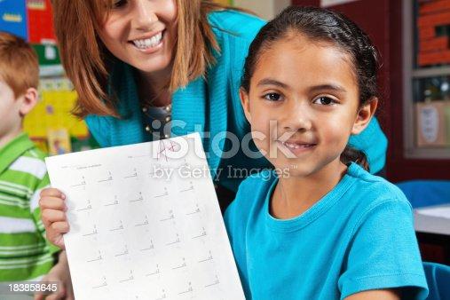 639569206 istock photo Proud School Girl Showing Her Good Grade 183858645