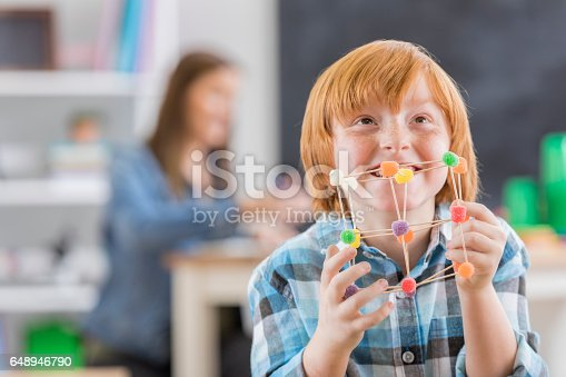 648947070 istock photo Proud schoolboy with engineering project 648946790