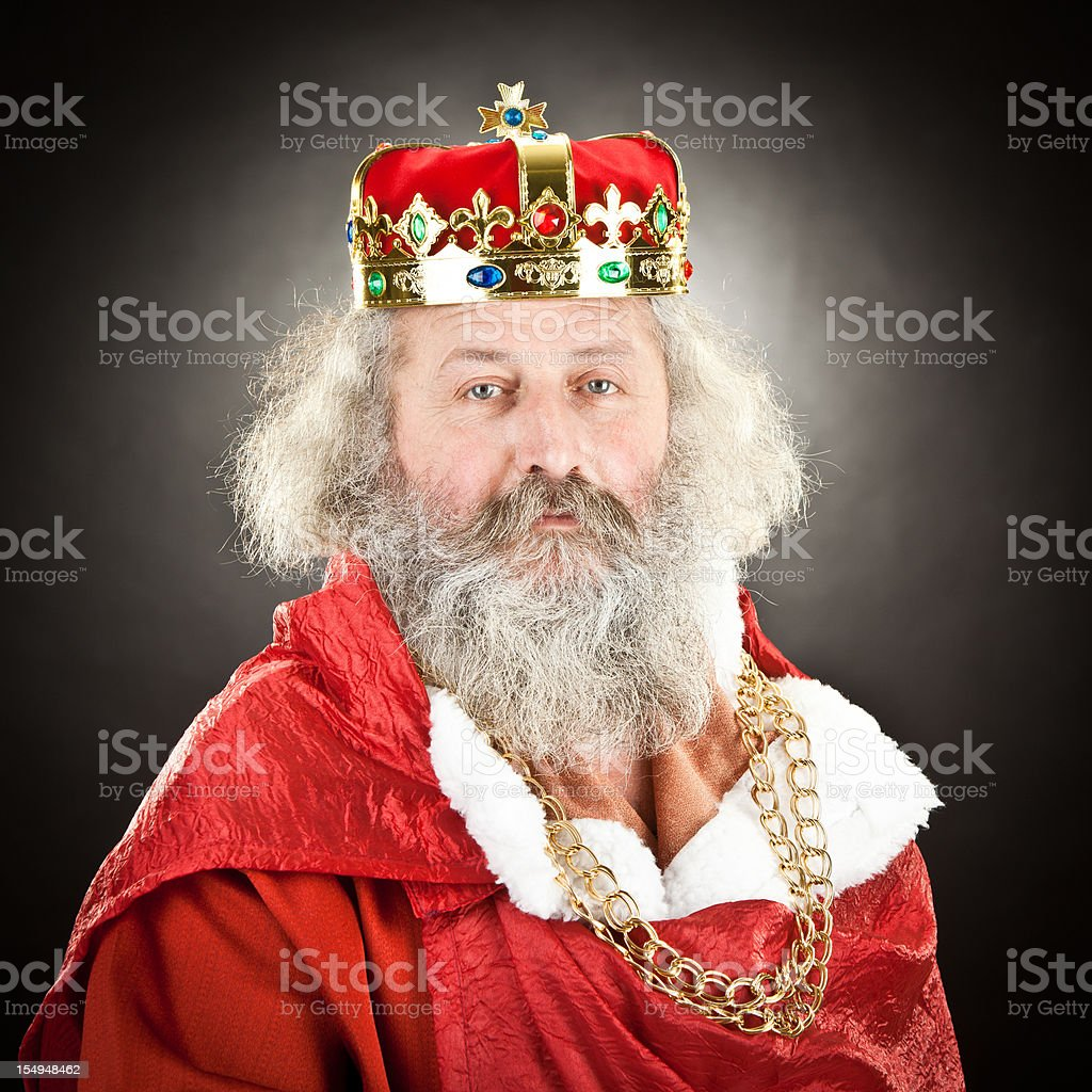 proud senior king or emperor with red cloak and crown royalty-free stock photo