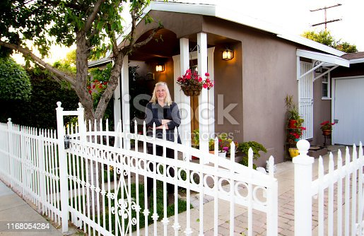 Proud Senior Woman Homeowner in Front of California House