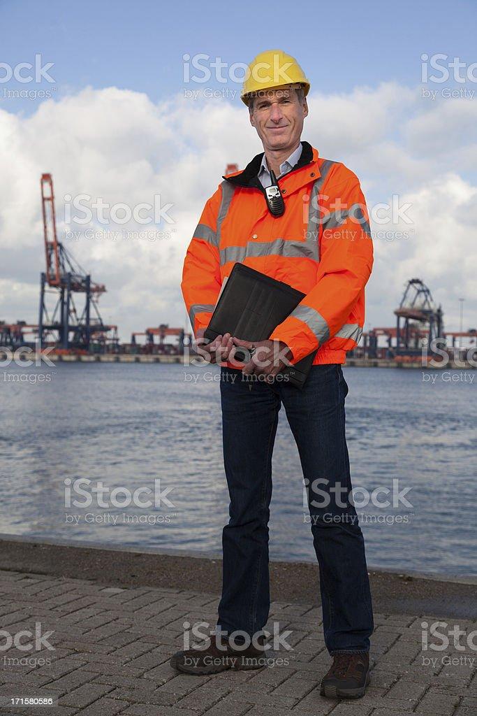 Proud smiling dock worker stock photo