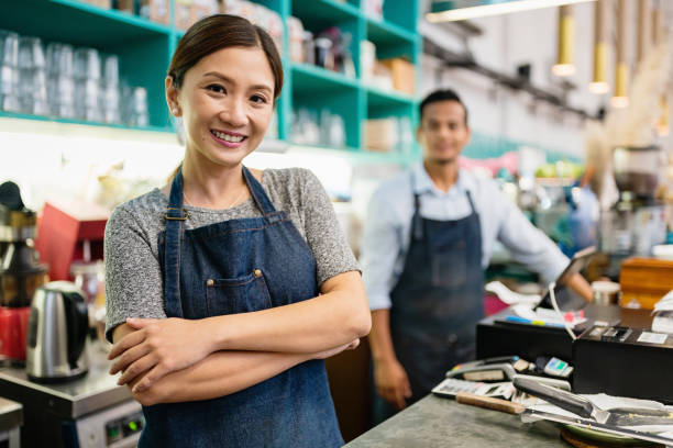 Proud Smiling Woman Coffee Shop Owner stock photo