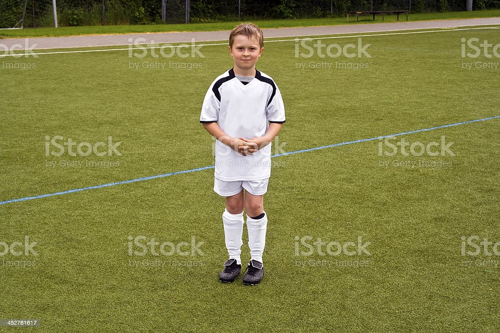 proud soccer player at the playground royalty-free stock photo