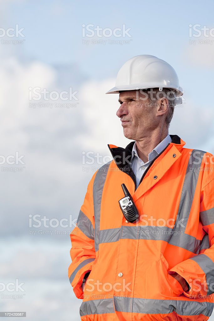 Proud technician in protective clothing stock photo
