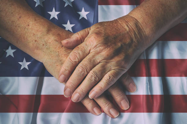 Proud to be an American Old woman's hands with American flag, top view. family 4th of july photos stock pictures, royalty-free photos & images