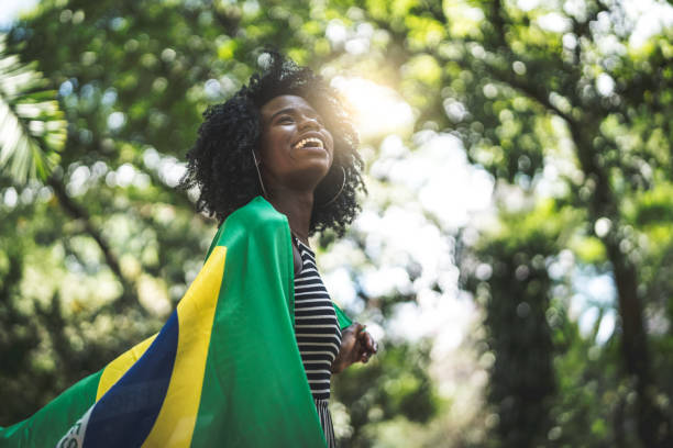 Proud to be Brazilian Brazilian Girl Celebrating with Brazil Flag brazilian culture stock pictures, royalty-free photos & images