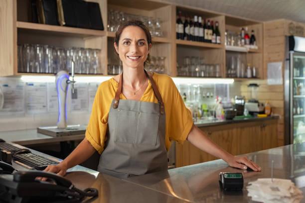 Proud waitress standing at counter picture id1180925357?b=1&k=6&m=1180925357&s=612x612&w=0&h=1uqvnqzbxdfllaut9tauzam6sreegahirzxctljvvd8=