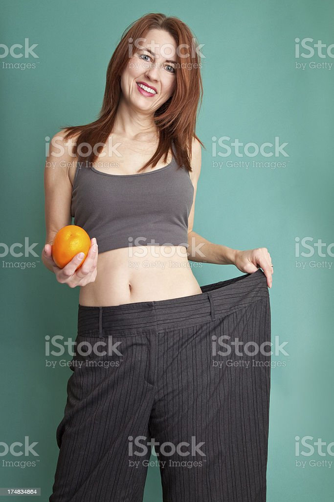 Proud Woman Showing Weight Loss royalty-free stock photo