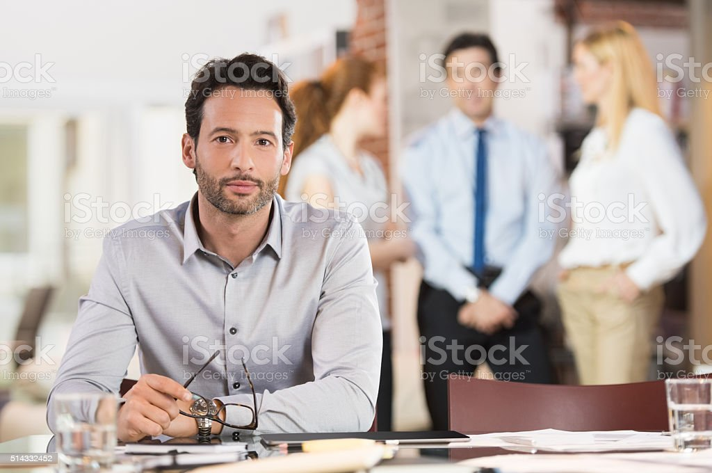 Proud young businessman stock photo