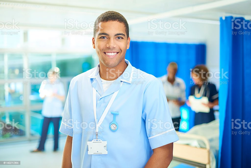 proud young student nurse on the ward stock photo