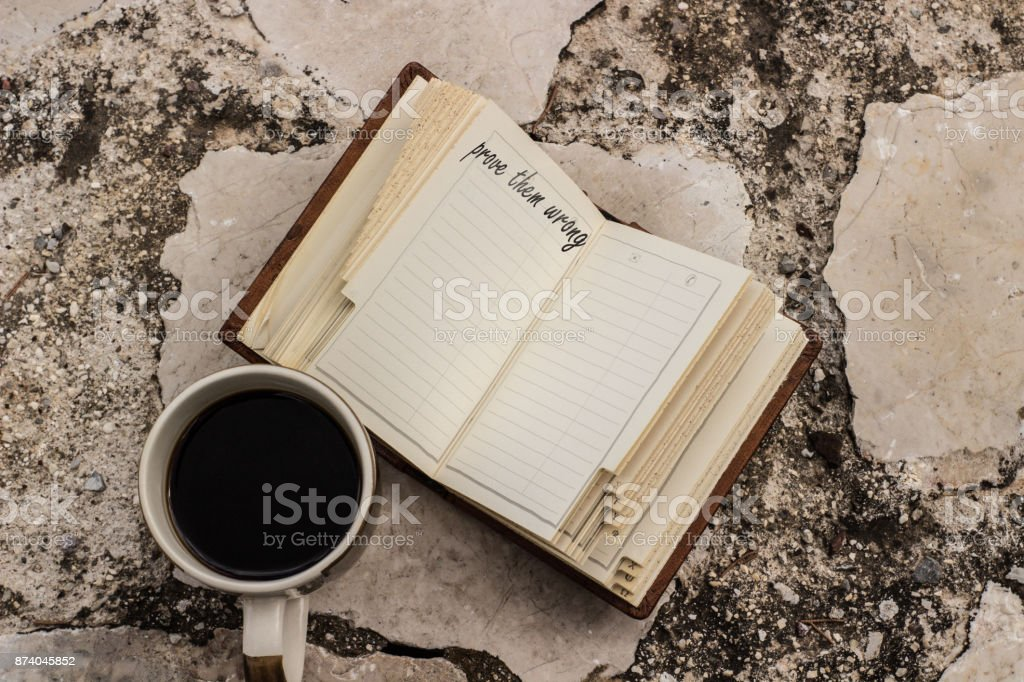 prove them wrong quote on a notebook stock photo
