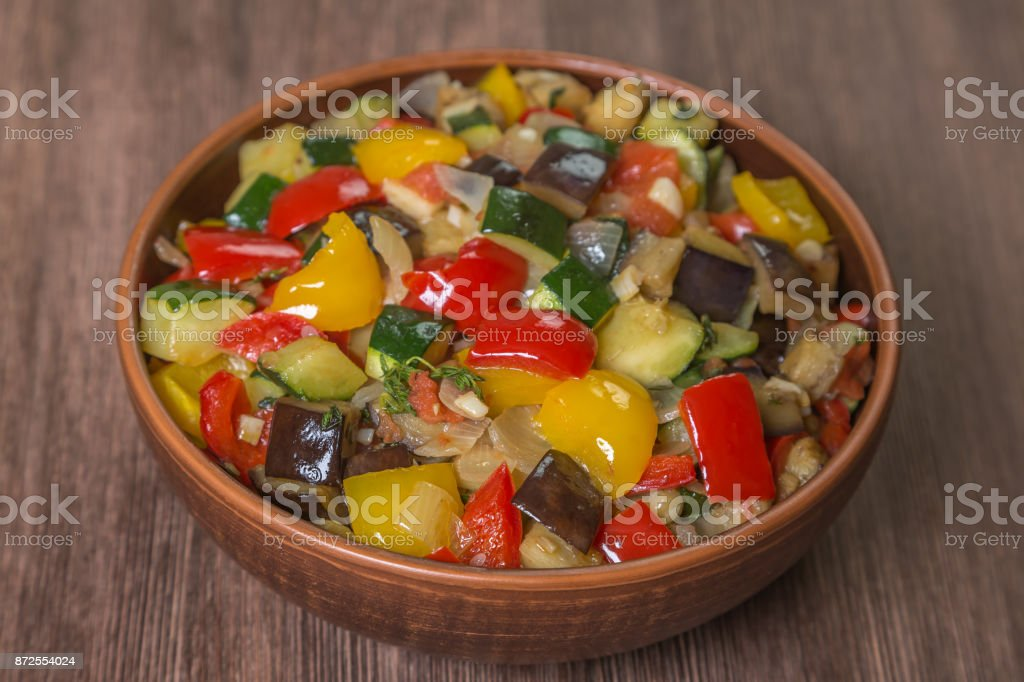 Provencal dish Ratatouille with ingredients for cooking in a pot made...