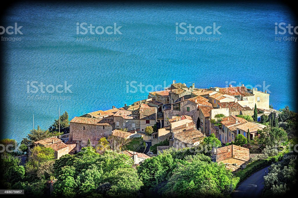 Provencal perched village over lake, France stock photo
