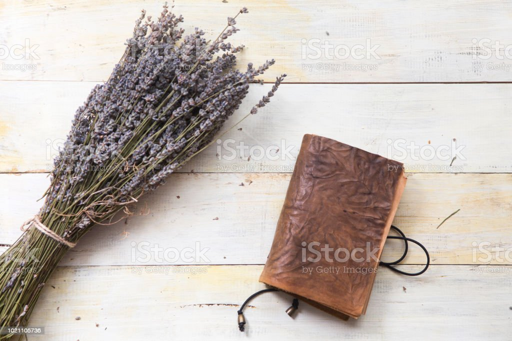 Provence Dried Lavender with handmade notebook on wooden table stock photo