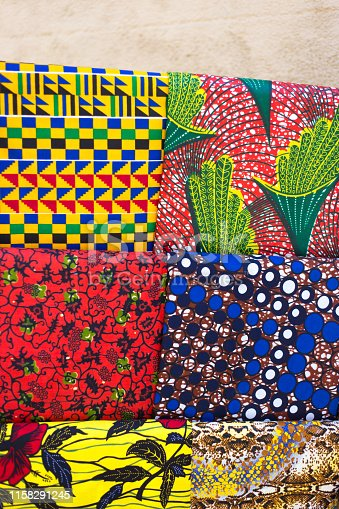 Provence, France: African Wax Textiles For Sale at Market. Shot at the weekly outdoor market in Aix-en-Provence in early June. Some copy space available at the top of the frame.