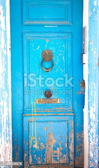 Provence, France: Antique Blue Door with Lion Door Knocker. Shot in Marseille. Copy space available.