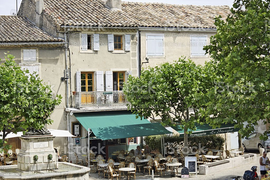 Provence: Public square with restaurant and street cafe in Grignan stock photo