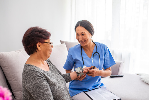 istock Providing care and support for elderly 1151243075