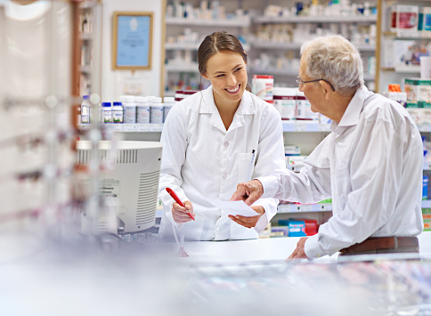 Shot of a young pharmacist helping an elderly customer at the prescription counter. The commercial product(s) or designs displayed in this image represent simulations of a real product, and are changed or altered enough so that they are free of any copyright infringements. Our team of retouching and design specialists custom designed these elements for each photo shoot http://195.154.178.81/DATA/i_collage/pi/shoots/785200.jpg