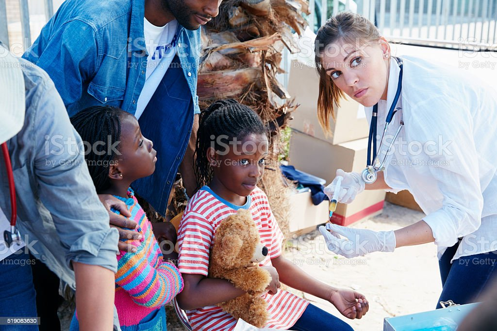 Providing free vaccinations to her community stock photo
