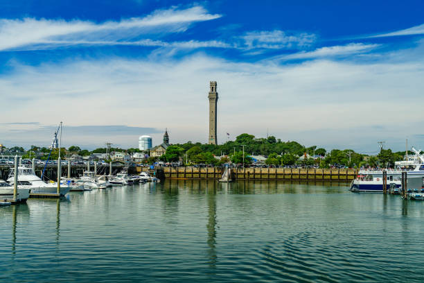 Provincetown Marina and Pilgrim Monument, Provincetown MA US Provincetown Marina and Pilgrim Monument, Provincetown MA US. provincetown stock pictures, royalty-free photos & images