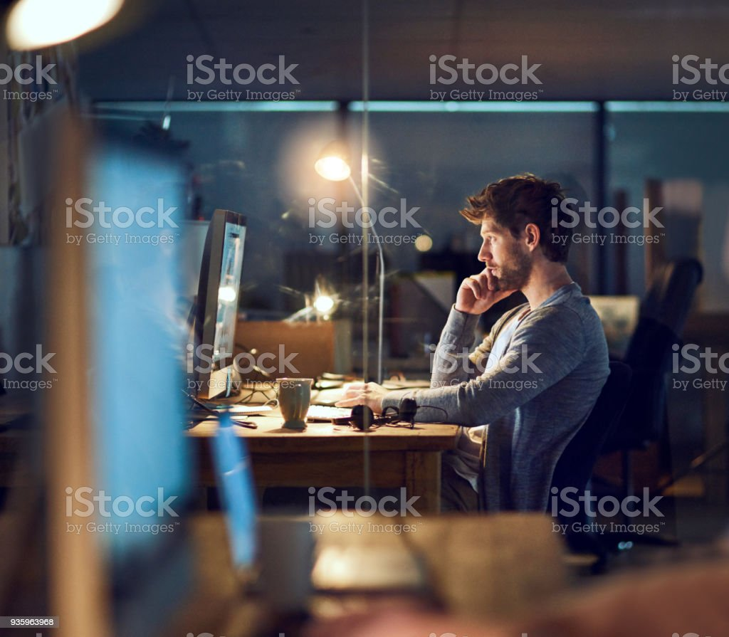 Proving his dedication right through the day and night stock photo