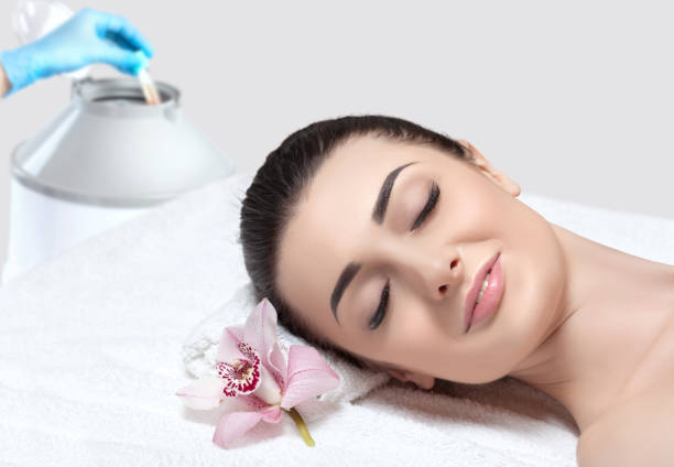 Prp therapy on the face and scalp of a beautiful, young woman with clean skin in a beauty salon. There is in vitro  blood plasma, ready for injection. Cosmetology and spa concept. stock photo