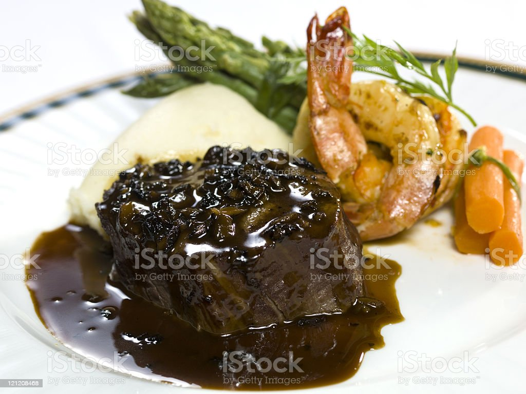 Prune sauce beef fillet with prawns royalty-free stock photo