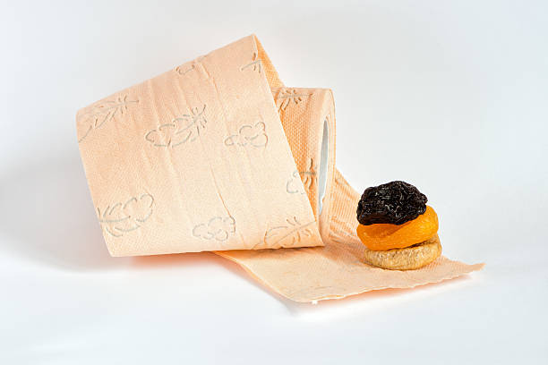 Cтоковое фото Prunes, сухое apricots, рис и Туалетная бумага