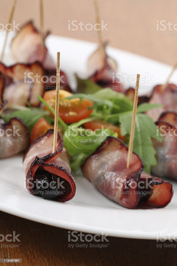 Prunes in bacon royalty-free stock photo