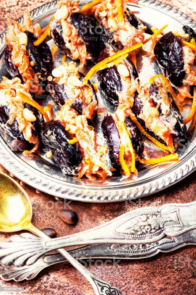 Prunes with walnut stock photo