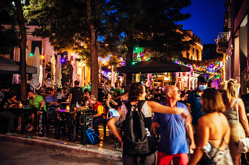 Athens, Greece - People enjoying hot summer night in Psirri district, famous by many bars and restaurants