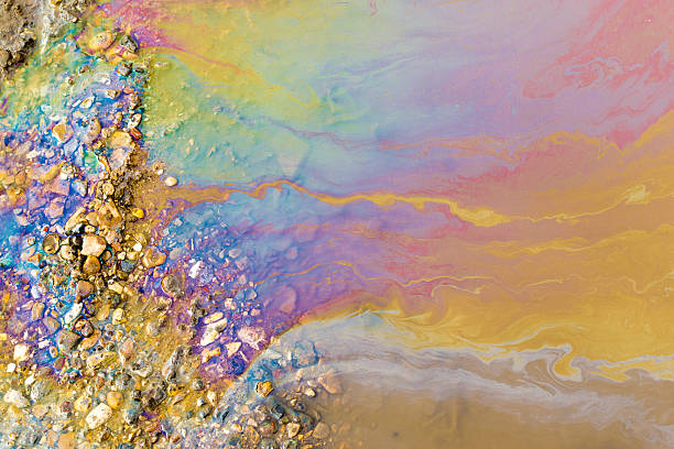 psychedelic abstract of toxic oil pollution on water - poisonous stock pictures, royalty-free photos & images